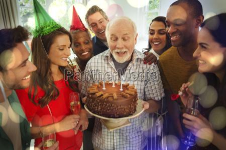 multi ethnic family watching senior man