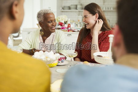 smiling women enjoying party at table