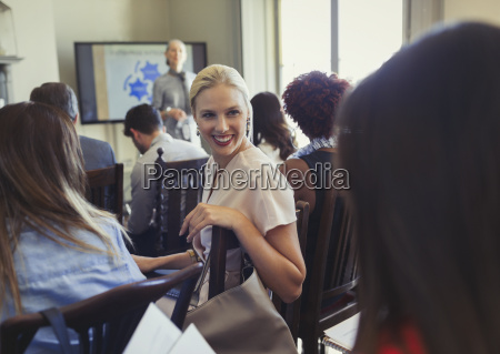 smiling businesswomen talking in business conference