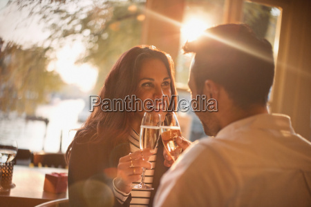 affectionate young couple toasting champagne glasses