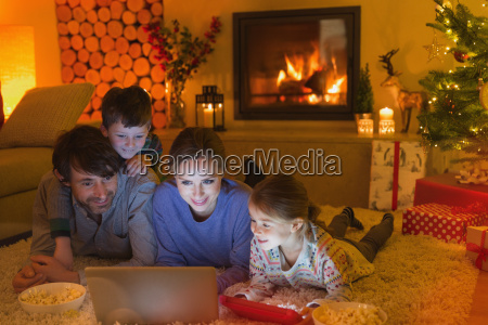 family eating popcorn and watching video