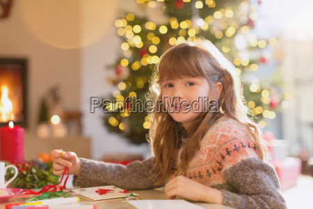 portrait smiling girl making christmas decorations