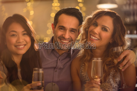 portrait smiling friends drinking champagne
