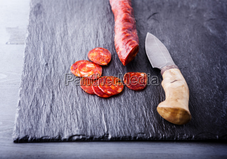 spanish chorizo with a knife on