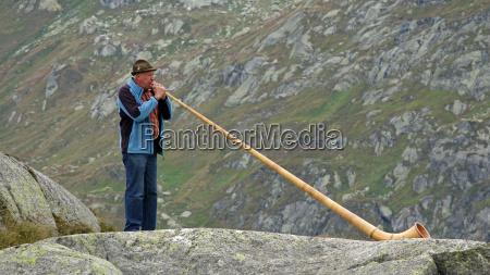 alpenhorn player at gotthard pass canton