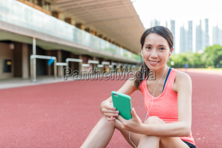 woman holding cellphone to check the