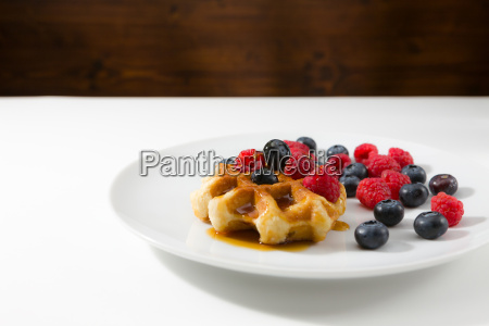 waffles with fresh ripe berries over