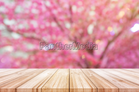 empty wooden table top with blurred