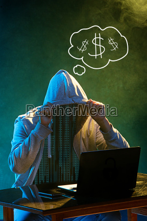 hooded computer hacker stealing information with