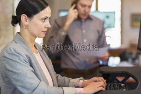 caucasian businesswoman using computer