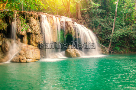 waterfall in deep forest at erawan