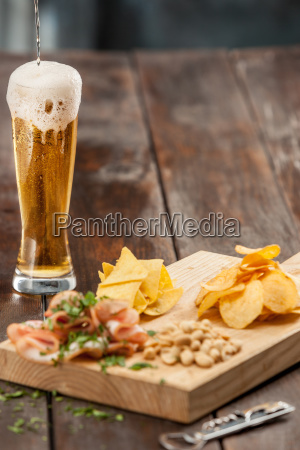beer glass and potato chips pistachios