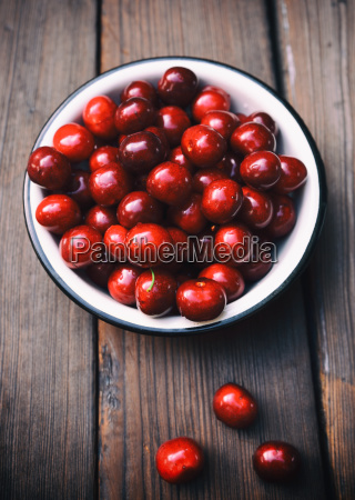 ripe red cherry in an iron